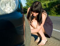 Woman repairing the car Stock Photography