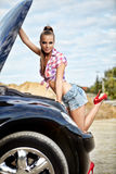 Woman repairing the car Stock Image