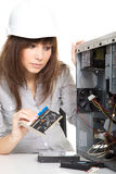 Woman repairing the computer Royalty Free Stock Photo