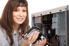 Woman repairing the computer Stock Image