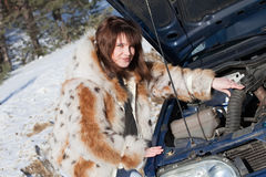 Woman repairing her car outdoo Stock Photo