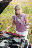 Woman repairing her car Royalty Free Stock Photo
