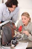 Woman repairing television Royalty Free Stock Photo