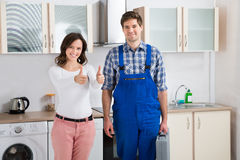 Woman With Repairman Showing Thumbs Up Sign Stock Photography