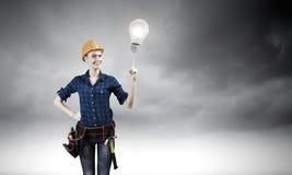 Woman repairman Stock Image