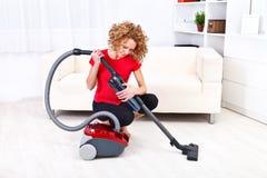 Woman repairs vacuum cleaner Stock Images
