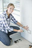 Woman reparing home Stock Photography