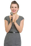 Woman reporter with microphone applauding isolated Stock Photos