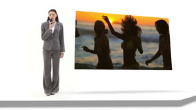 Woman reporting on fun at the beach Stock Photography