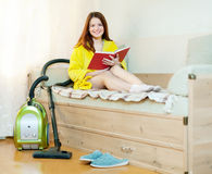Woman reposes from household chores Royalty Free Stock Photos