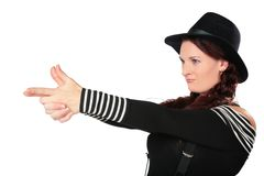 Woman represents shooting from a pistol Royalty Free Stock Photography