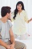 Woman reprimanding her boyfriend Stock Images