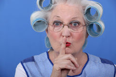 Woman requesting to be quiet. Old woman requesting you to be quiet Stock Photography