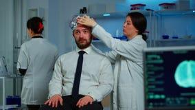 Woman researcher putting brainwave scanning headset