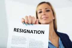 Woman resigning with a smile on her face