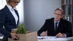 Woman resigning from work, gender discrimination, humiliation of womens rights. Stock photo stock images