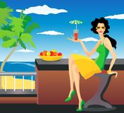 Woman on resort. Beautiful woman with cocktail sitting near the sea on resort Royalty Free Stock Photo