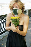 Woman in respirator with flower Royalty Free Stock Photography