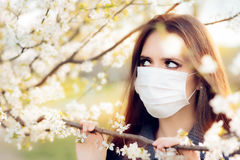 Woman with Respirator Mask Fighting Spring Allergies Outdoor Royalty Free Stock Photography