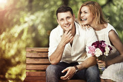 Woman responded to a marriage proposal. Love and marriage concept. Young attractive cheerful couple in the park and smiling. Woman responded to a marriage Royalty Free Stock Image