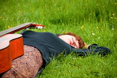 Woman rest on the grass Stock Image
