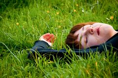 Woman rest on the grass Royalty Free Stock Photography