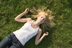 Woman rest on the grass Royalty Free Stock Photo