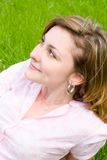 Woman rest on the grass Stock Photography