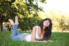 Woman rest on the green grass Royalty Free Stock Images