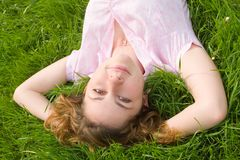 Woman rest on the green grass Stock Image