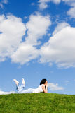 Woman rest on the green grass. Pretty woman rest on the green grass Royalty Free Stock Image
