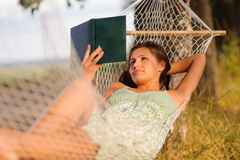 Woman rest in hammock Stock Images