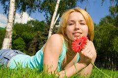 Woman Rest In The Park With Flower Royalty Free Stock Photography