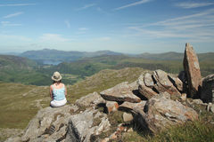 Woman at rest in Lake District. Woman admiring stunning view royalty free stock photos