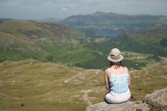 Woman at rest in Lake District,focus on woman. Woman admiring stunning view Stock Photos