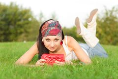 Woman rest in the park Royalty Free Stock Photo