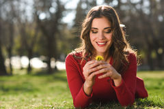 Woman rest in the park with dandelions Stock Photography