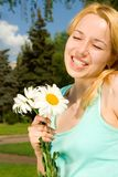 Woman rest in the park with flowers Stock Images