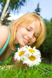 Woman rest in the park with flowers Royalty Free Stock Photos