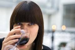 The woman at restaurant. Drinks wine Stock Photo