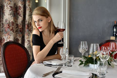 Woman at restaurant Stock Images