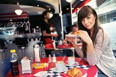 Woman at restaurant Stock Photography