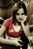Woman at a restaurant Stock Images
