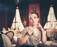 Woman in a restaurant Stock Images