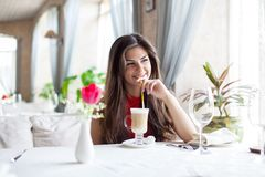 Woman in  restaurant is drinking cocktail Stock Image