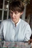 Woman at restaurant with menu Stock Photo