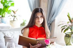 A woman in a restaurant with the menu in hands Royalty Free Stock Photography