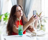 Woman in restaurant is taking photos Stock Photo