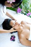 Woman restful while having a facial massage Royalty Free Stock Photos