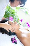 Woman restful while having a facial therapy Royalty Free Stock Photography